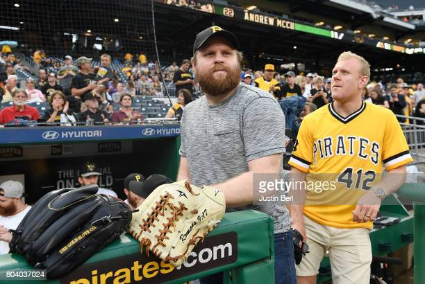 Phil Kessel and Patric Hornqvist of the Pittsburgh Penguins look on from the dugout before the game between the Pittsburgh Pirates and the Colorado...