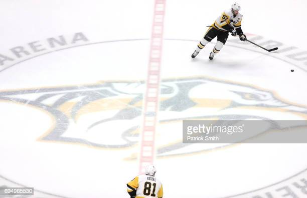 Phil Kessel and Sidney Crosby of the Pittsburgh Penguins warm up prior to the start of Game Six of the 2017 NHL Stanley Cup Final against the...