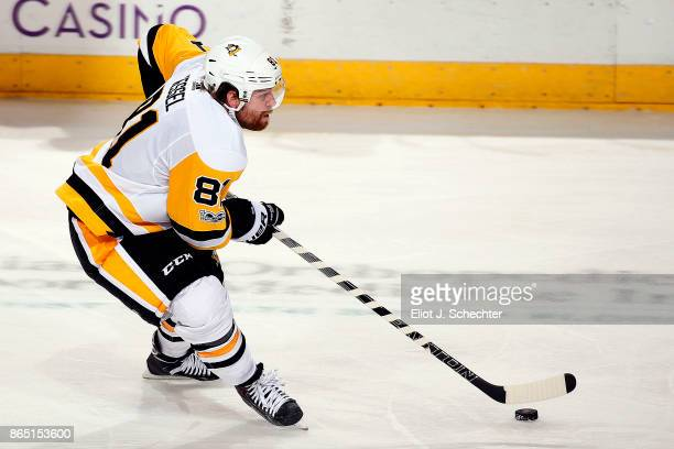 Phil Kessel of the Pittsburg Penguins skates with the puck against the Florida Panthers at the BBT Center on October 20 2017 in Sunrise Florida
