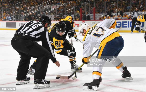 Phil Kessel of the Pittsburgh Penguins and Nick Bonino of the Nashville Predators take a faceoff at PPG Paints Arena on October 7 2017 in Pittsburgh...