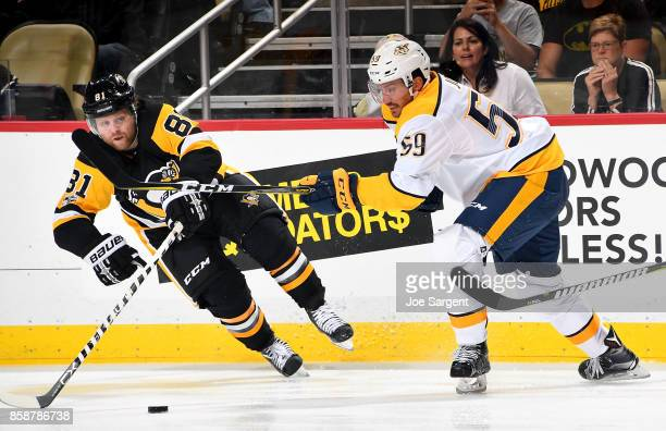 Phil Kessel of the Pittsburgh Penguins and Roman Josi of the Nashville Predators battle for the puck at PPG Paints Arena on October 7 2017 in...