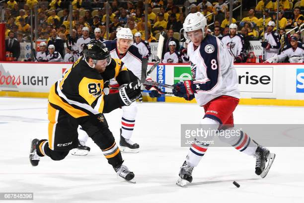 Phil Kessel of the Pittsburgh Penguins and Zach Werenski of the Columbus Blue Jackets battle for the puck in Game One of the Eastern Conference First...