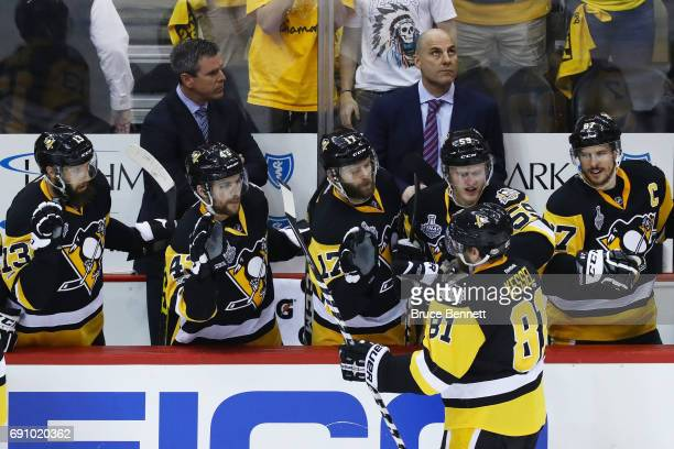 Phil Kessel of the Pittsburgh Penguins celebrates a goal by Evgeni Malkin with teammates on the bench during the third period in Game Two of the 2017...