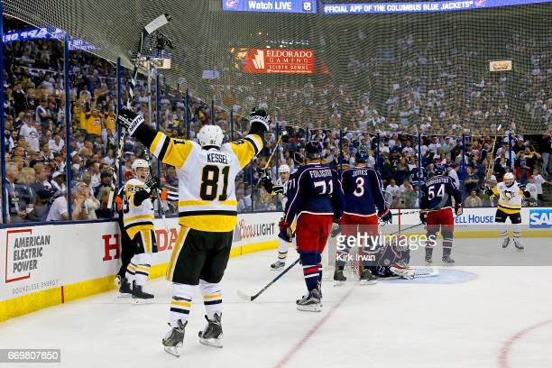 Phil Kessel of the Pittsburgh Penguins celebrates after Jake Guentzel of the Pittsburgh Penguins scored a goal during Game Three of the Eastern...