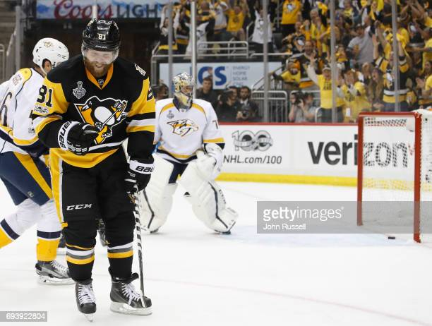 Phil Kessel of the Pittsburgh Penguins celebrates his goal as goaltender Juuse Saros of the Nashville Predators reacts during the second period of...