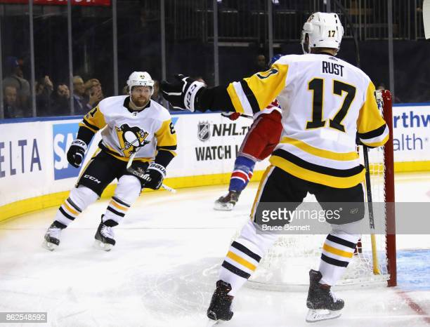 Phil Kessel of the Pittsburgh Penguins celebrates his goal at 47 seconds of the first period against the New York Rangers and is joined by Bryan Rust...