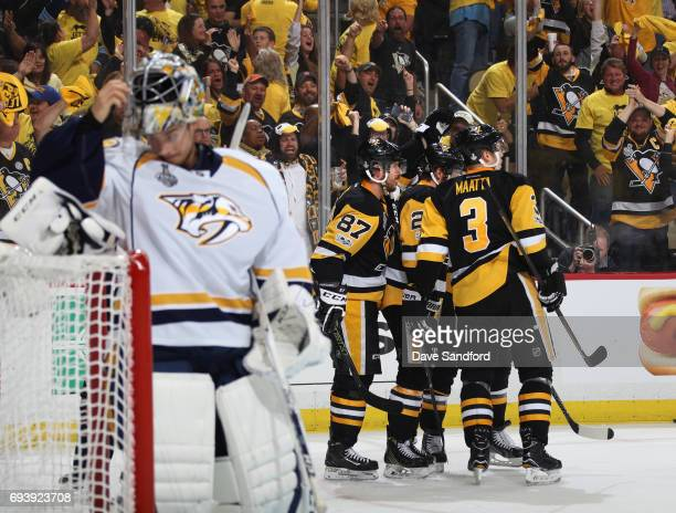 Phil Kessel of the Pittsburgh Penguins celebrates his goal with teammates as goaltender Juuse Saros of the Nashville Predators reacts during the...