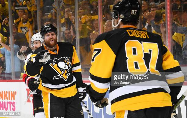 Phil Kessel of the Pittsburgh Penguins celebrates his goal with Sidney Crosby during the third period against the Ottawa Senators in Game Five of the...