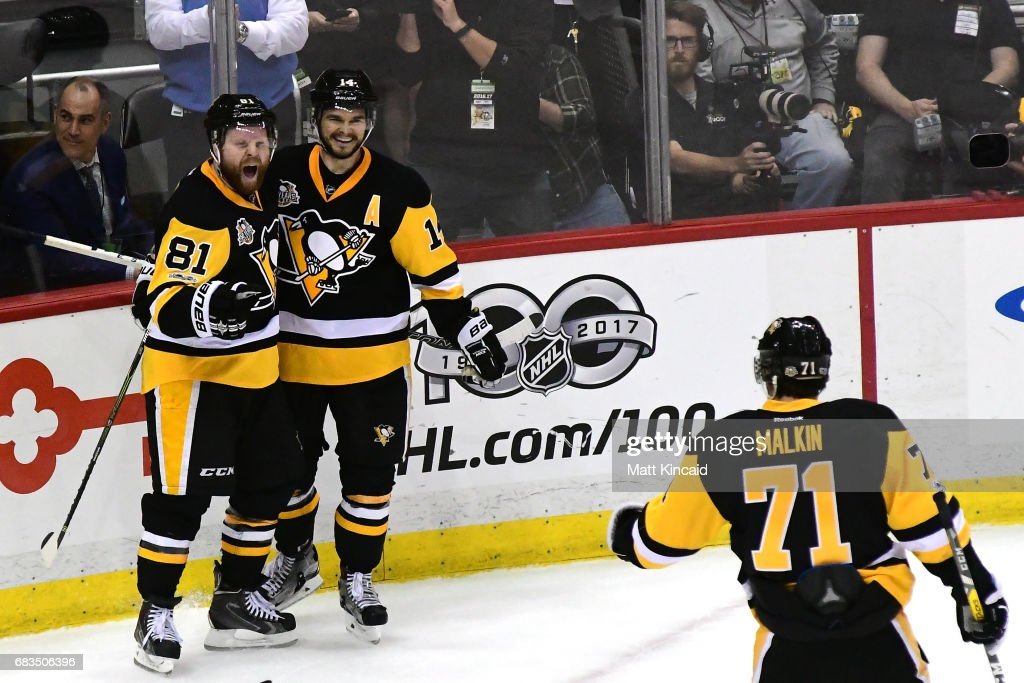 Phil Kessel #81 of the Pittsburgh Penguins celebrates with Chris Kunitz #14 and Evgeni Malkin #71 after scoring a goal against Craig Anderson #41 of the Ottawa Senators during the third period in Game Two of the Eastern Conference Final during the 2017 NHL Stanley Cup Playoffs at PPG PAINTS Arena on May 15, 2017 in Pittsburgh, Pennsylvania.