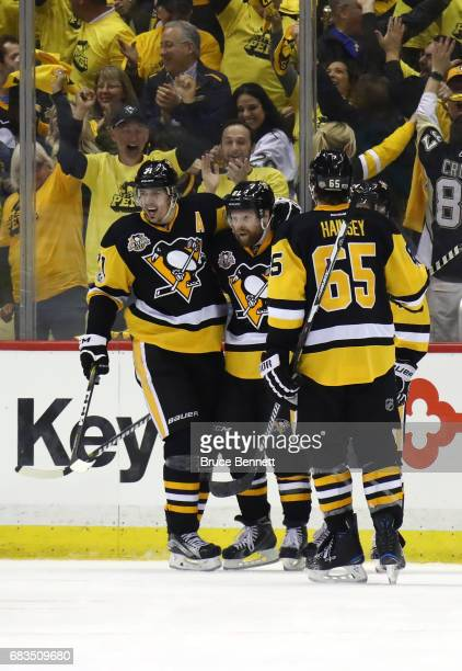 Phil Kessel of the Pittsburgh Penguins celebrates with his teammates after scoring a goal against Craig Anderson of the Ottawa Senators during the...
