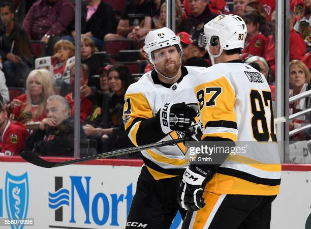 Phil Kessel of the Pittsburgh Penguins celebrates with Sidney Crosby after scoring against the Chicago Blackhawks in the second period at the United...