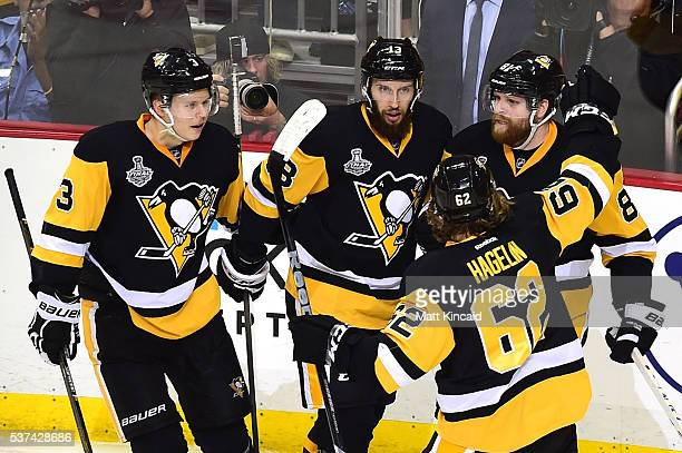 Phil Kessel of the Pittsburgh Penguins celebrates with teammates after scoring a second period goal against Martin Jones of the San Jose Sharks in...