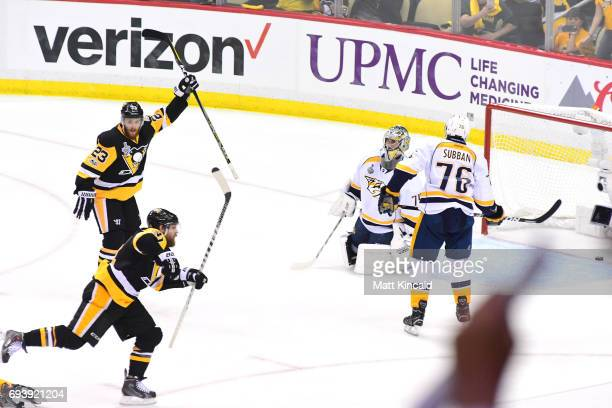 Phil Kessel of the Pittsburgh Penguins celebrates with teammates after scoring his team's fifth goal against the Nashville Predators in the second...