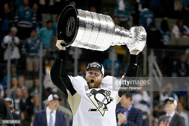 Phil Kessel of the Pittsburgh Penguins celebrates with the Stanley Cup after their 31 victory to win the Stanley Cup against the San Jose Sharks in...