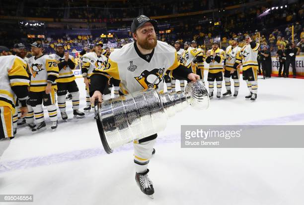 Phil Kessel of the Pittsburgh Penguins celebrates with the Stanley Cup Trophy after they defeated the Nashville Predators 20 in Game Six of the 2017...