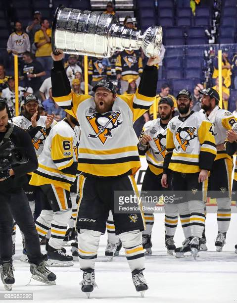 Phil Kessel of the Pittsburgh Penguins celebrates with the Stanley Cup trophy after defeating the Nashville Predators 20 in Game Six of the 2017 NHL...