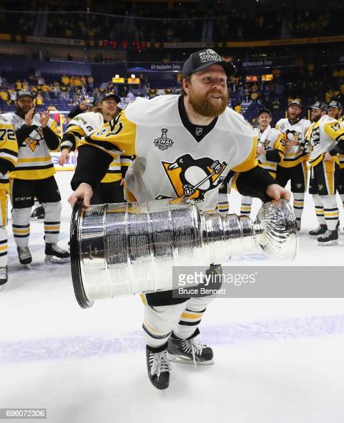 Phil Kessel of the Pittsburgh Penguins celebrates with the Stanley Cup following a victory over the Nashville Predators in Game Six of the 2017 NHL...