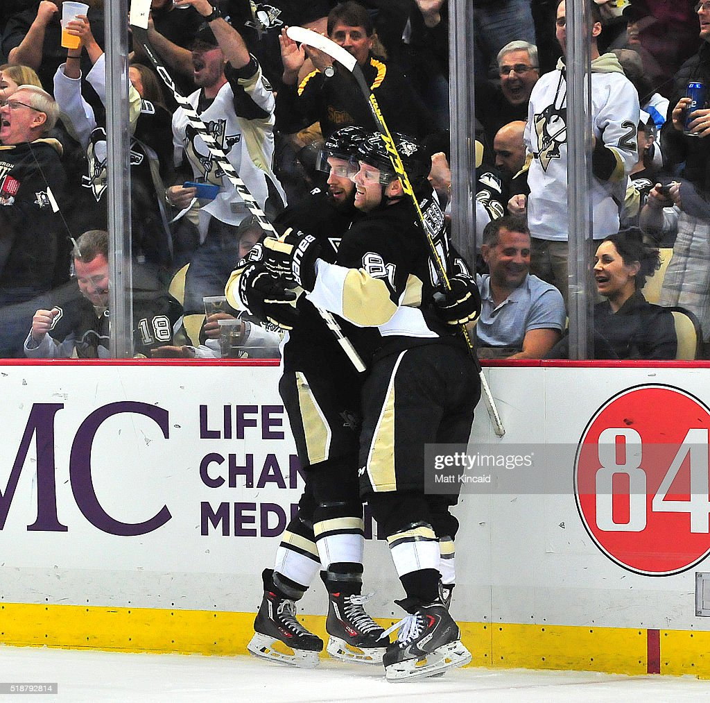 Phil Kessel #81 of the Pittsburgh Penguins congratulates Nick Bonino #13 after he scored a goal against the Nashville Predators at Consol Energy Center on March 31, 2016 in Pittsburgh, Pennsylvania.