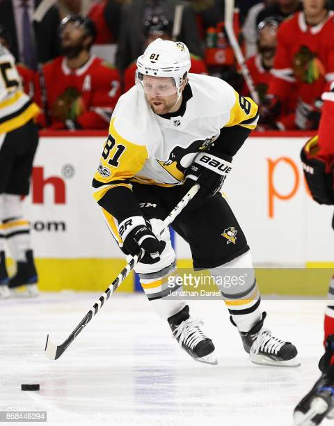 Phil Kessel of the Pittsburgh Penguins controls the puck against the Chicago Blackhawks during the season opening game at the United Center on...
