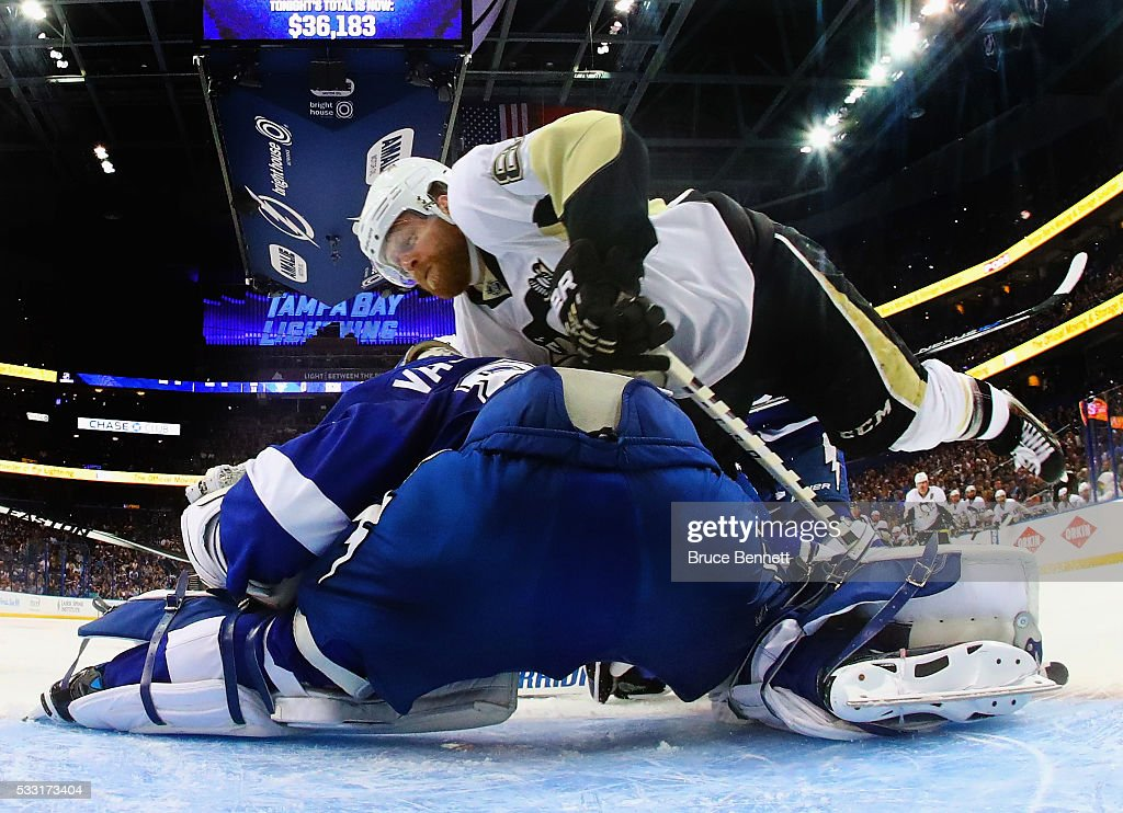<a gi-track='captionPersonalityLinkClicked' href=/galleries/search?phrase=Phil+Kessel&family=editorial&specificpeople=537794 ng-click='$event.stopPropagation()'>Phil Kessel</a> #81 of the Pittsburgh Penguins flies into <a gi-track='captionPersonalityLinkClicked' href=/galleries/search?phrase=Andrei+Vasilevskiy+-+Ice+Hockey+Player&family=editorial&specificpeople=9594320 ng-click='$event.stopPropagation()'>Andrei Vasilevskiy</a> #88 of the Tampa Bay Lightning in Game Four of the Eastern Conference Final during the 2016 NHL Stanley Cup Playoffs at the Amalie Arena on May 20, 2016 in Tampa, Florida. The Lightning defeated the Penguins 4-3.