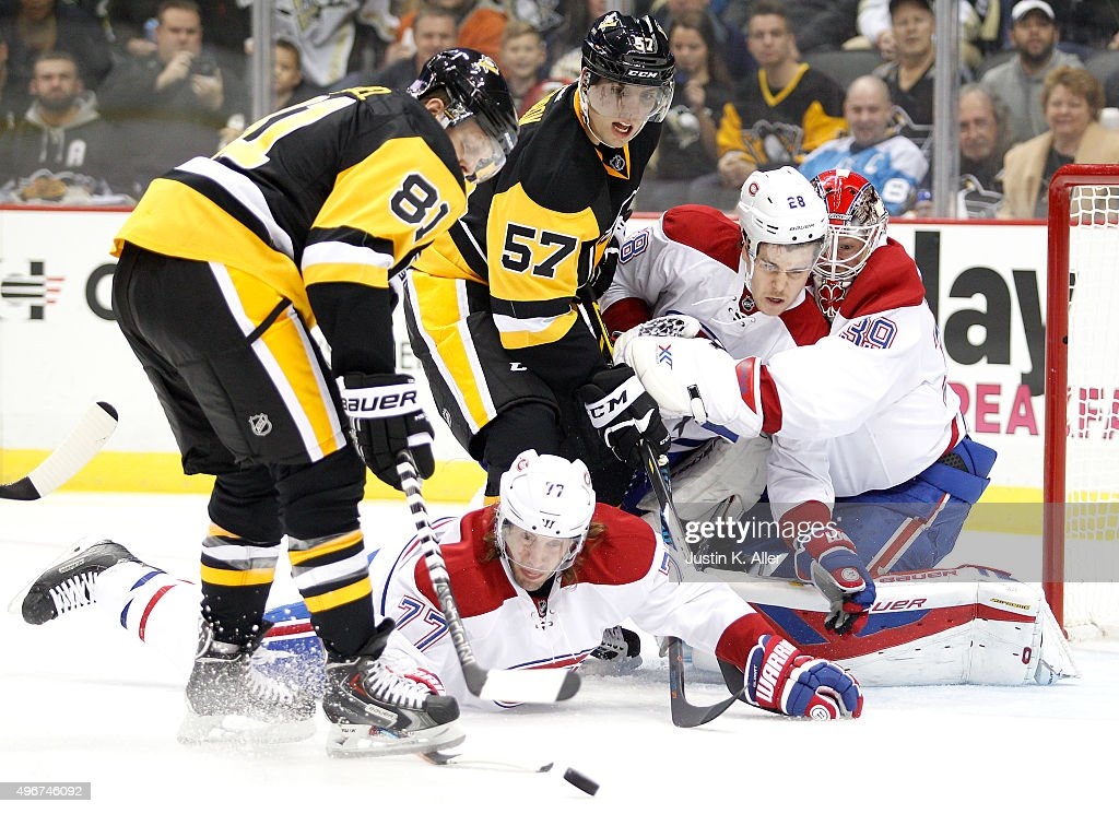 Phil Kessel of the Pittsburgh Penguins handles the puck in front of Mike Condon Nathan Beaulieu and Tom Gilbert of the Montreal Canadiens during the...