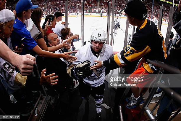 Phil Kessel of the Pittsburgh Penguins highfives fans as he leaves the ice following warmups to the NHL game against the Arizona Coyotes at Gila...