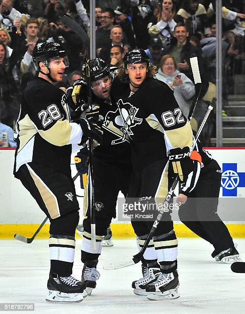 Phil Kessel of the Pittsburgh Penguins is congratulated by teammates after scoring a goal against the Nashville Predators at Consol Energy Center on...