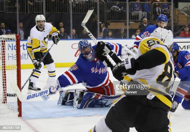 Phil Kessel of the Pittsburgh Penguins misses a third period shot against Henrik Lundqvist of the New York Rangers at Madison Square Garden on...