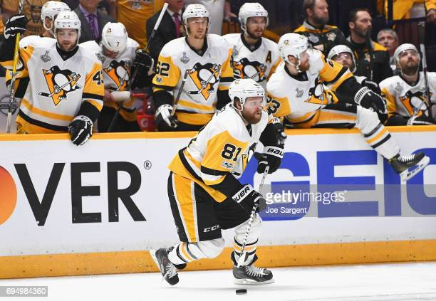 Phil Kessel of the Pittsburgh Penguins moves the puck in front of his bench during the first period of Game Six of the 2017 NHL Stanley Cup Final...