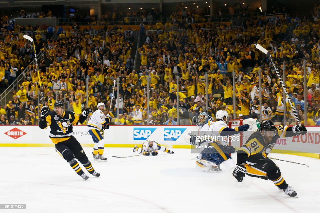Phil Kessel #81 of the Pittsburgh Penguins reacts after a goal by Evgeni Malkin #71 during the third period in Game Two of the 2017 NHL Stanley Cup Final against the Nashville Predators at PPG Paints Arena on May 31, 2017 in Pittsburgh, Pennsylvania.