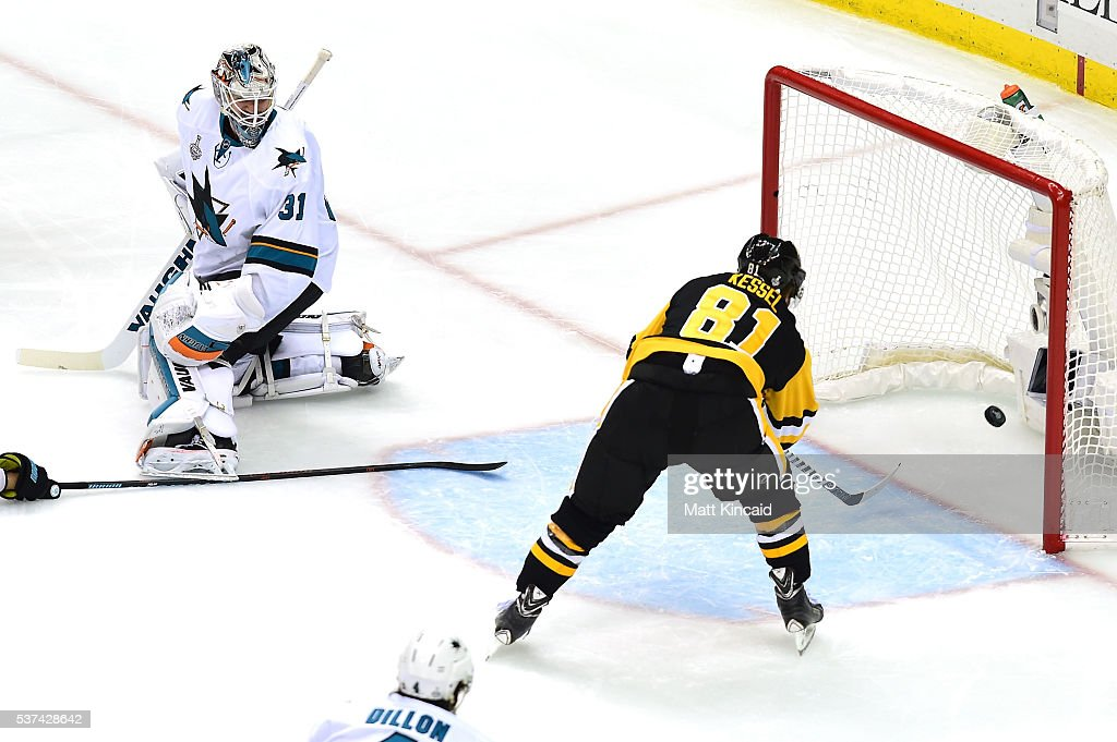 <a gi-track='captionPersonalityLinkClicked' href=/galleries/search?phrase=Phil+Kessel&family=editorial&specificpeople=537794 ng-click='$event.stopPropagation()'>Phil Kessel</a> #81 of the Pittsburgh Penguins scores a second period goal against <a gi-track='captionPersonalityLinkClicked' href=/galleries/search?phrase=Martin+Jones+-+Ice+Hockey+Player&family=editorial&specificpeople=12318960 ng-click='$event.stopPropagation()'>Martin Jones</a> #31 of the San Jose Sharks in Game Two of the 2016 NHL Stanley Cup Final at Consol Energy Center on June 1, 2016 in Pittsburgh, Pennsylvania.