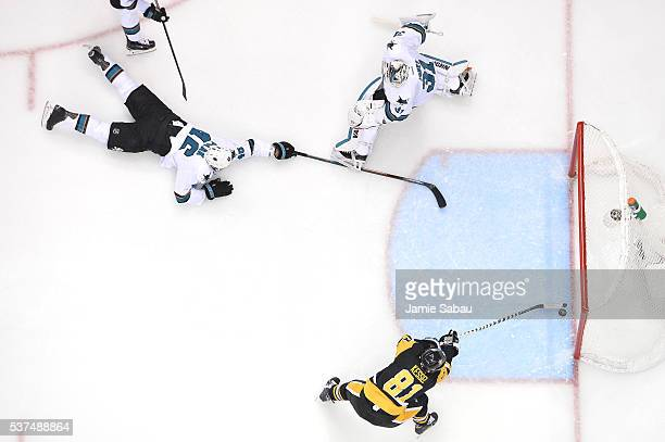 Phil Kessel of the Pittsburgh Penguins scores a second period goal against Martin Jones of the San Jose Sharks as Roman Polak attempts to defend in...