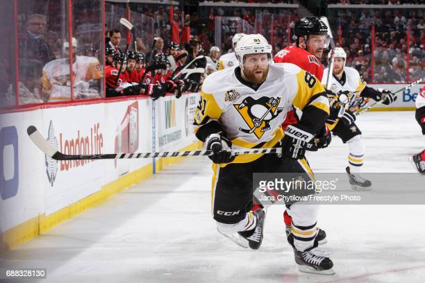 Phil Kessel of the Pittsburgh Penguins skates against Dion Phaneuf of the Ottawa Senators in Game Six of the Eastern Conference Final during the 2017...