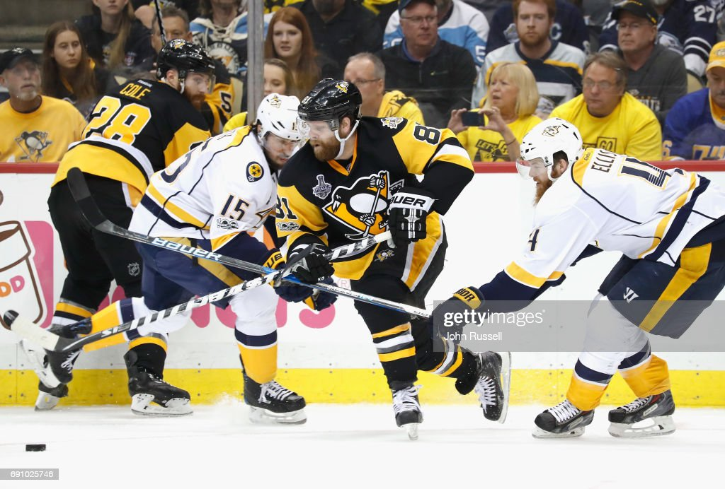 Phil Kessel #81 of the Pittsburgh Penguins skates away with the puck between Craig Smith #15 and Ryan Ellis #4 of the Nashville Predators during the second period of Game Two of the 2017 NHL Stanley Cup Final at PPG Paints Arena on May 31, 2017 in Pittsburgh, Pennslyvannia.