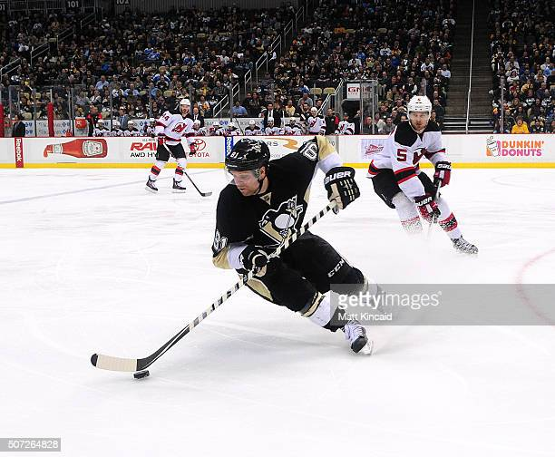 Phil Kessel of the Pittsburgh Penguins skates with the puck against the New Jersey Devils at Consol Energy Center on January 26 2016 in Pittsburgh...