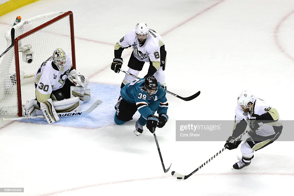 Phil Kessel #81 of the Pittsburgh Penguins takes possesion of the puck from Logan Couture #39 of the San Jose Sharks in Game Four of the 2016 NHL Stanley Cup Final at SAP Center on June 6, 2016 in San Jose, California.