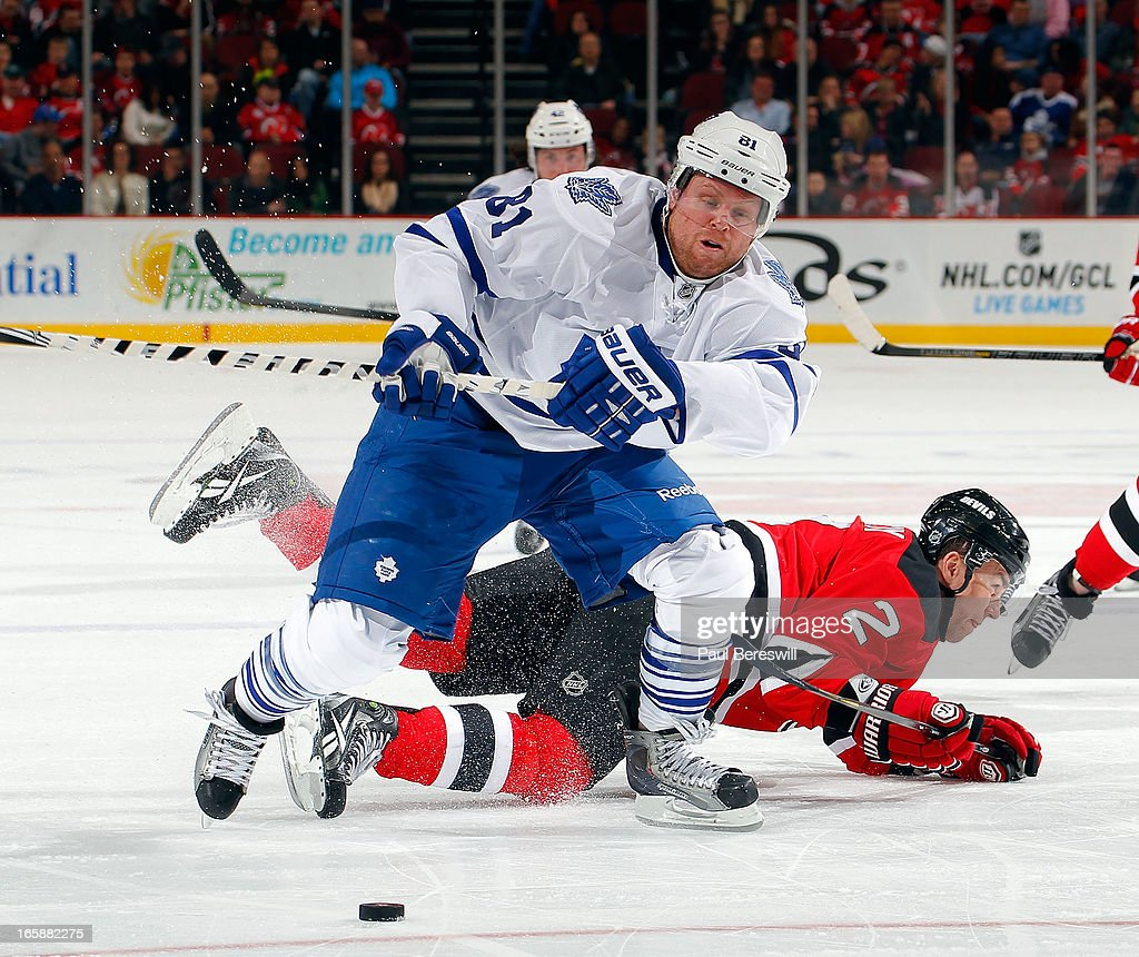 Phil Kessel #81 of the Toronto Maple Leafs breaks away from Marek Zidlicky #2 of the New Jersey Devils during the third period of an NHL hockey game at Prudential Center on April 6, 2013 in Newark, New Jersey.