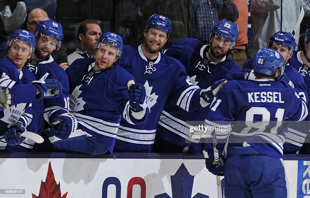 <a gi-track='captionPersonalityLinkClicked' href=/galleries/search?phrase=Phil+Kessel&family=editorial&specificpeople=537794 ng-click='$event.stopPropagation()'>Phil Kessel</a> #81 of the Toronto Maple Leafs celebrates a third period goal with teammates in Game Six of the Eastern Conference Quarterfinals against the Boston Bruins during the 2013 NHL Stanley Cup Playoffs May 12, 2013 at the Air Canada Centre in Toronto, Ontario, Canada.