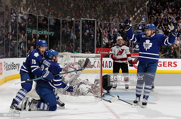 Phil Kessel of the Toronto Maple Leafs celebrates his power play goal at 812 of the third period against the New Jersey Devils and is joined by...