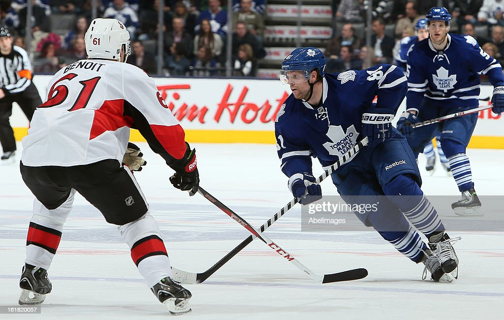 Phil Kessel #81 of the Toronto Maple Leafs gets around Andre Benoit #61 of the Ottawa Senators during NHL action at the Air Canada Centre February 16, 2013 in Toronto, Ontario, Canada.