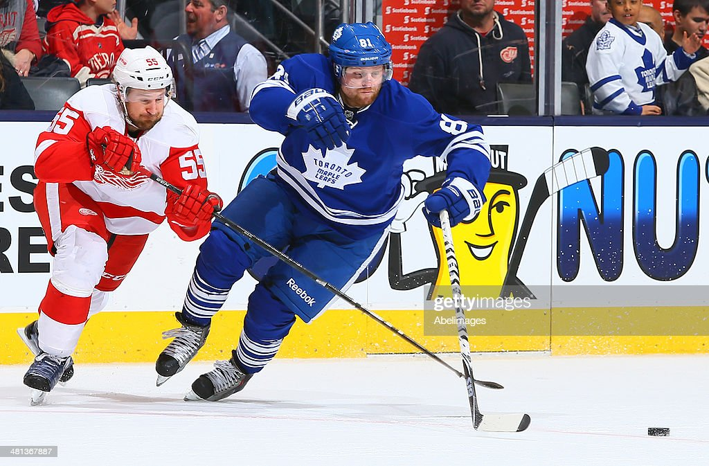 <a gi-track='captionPersonalityLinkClicked' href=/galleries/search?phrase=Phil+Kessel&family=editorial&specificpeople=537794 ng-click='$event.stopPropagation()'>Phil Kessel</a> #81 of the Toronto Maple Leafs gets around <a gi-track='captionPersonalityLinkClicked' href=/galleries/search?phrase=Niklas+Kronwall&family=editorial&specificpeople=220826 ng-click='$event.stopPropagation()'>Niklas Kronwall</a> #55 of the Detroit Red Wings during NHL action at the Air Canada Centre March 29, 2014 in Toronto, Ontario, Canada.