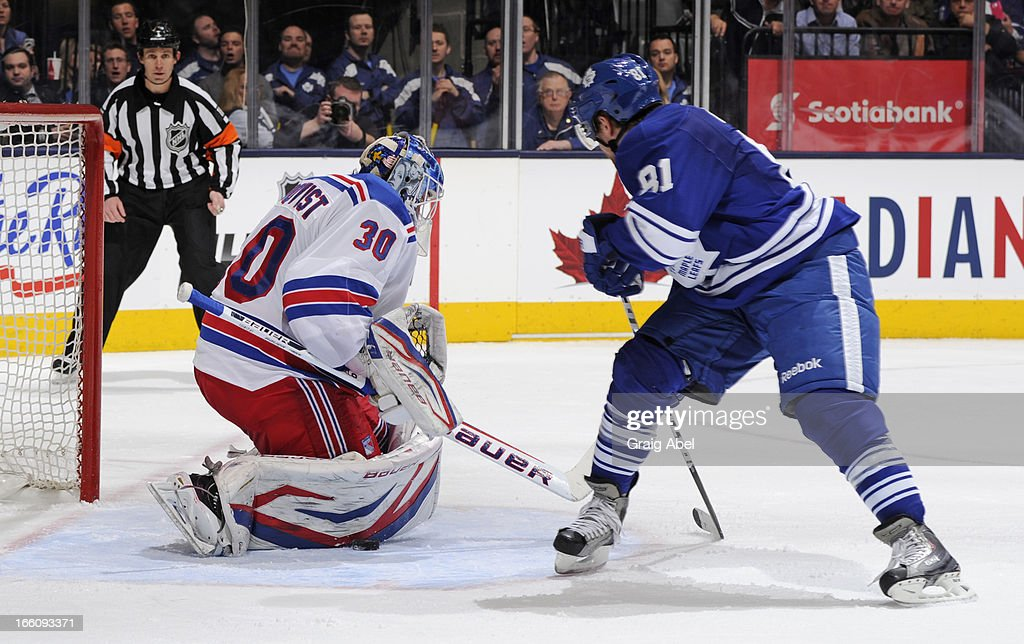 Phil Kessel #81 of the Toronto Maple Leafs is stopped in close by Henrik Lundqvist #30 of the New York Rangers during NHL game action. Kessel would eventually score on his own rebound April 8, 2013 at the Air Canada Centre in Toronto, Ontario, Canada.