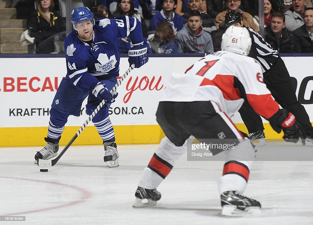 <a gi-track='captionPersonalityLinkClicked' href=/galleries/search?phrase=Phil+Kessel&family=editorial&specificpeople=537794 ng-click='$event.stopPropagation()'>Phil Kessel</a> #81 of the Toronto Maple Leafs looks to pass the puck as Andre Benoit #61 of the Ottawa Senators defends during NHL game action February 16, 2013 at the Air Canada Centre in Toronto, Ontario, Canada.