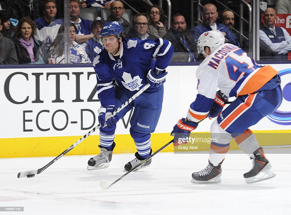 <a gi-track='captionPersonalityLinkClicked' href=/galleries/search?phrase=Phil+Kessel&family=editorial&specificpeople=537794 ng-click='$event.stopPropagation()'>Phil Kessel</a> #81 of the Toronto Maple Leafs looks to shoot the puck as Andrew MacDonald #47 of the New York Islanders defends during NHL game action January 24, 2013 at the Air Canada Centre in Toronto, Ontario, Canada.