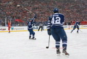 Phil Kessel of the Toronto Maple Leafs reacts after teammate Tyler Bozak of the Toronto Maple Leafs scored a goal in the third period as Justin...