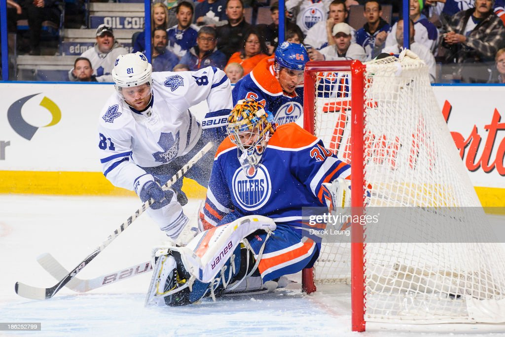 Phil Kessel of the Toronto Maple Leafs scores a goal against Richard Bachman of the Edmonton Oilers during an NHL game on October 29 2013 at Rexall...