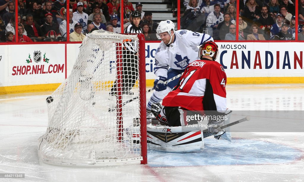 <a gi-track='captionPersonalityLinkClicked' href=/galleries/search?phrase=Phil+Kessel&family=editorial&specificpeople=537794 ng-click='$event.stopPropagation()'>Phil Kessel</a> #81 of the Toronto Maple Leafs scores a second period goal against <a gi-track='captionPersonalityLinkClicked' href=/galleries/search?phrase=Craig+Anderson&family=editorial&specificpeople=211238 ng-click='$event.stopPropagation()'>Craig Anderson</a> #41 of the Ottawa Senators at Canadian Tire Centre on December 7, 2013 in Ottawa, Ontario, Canada.
