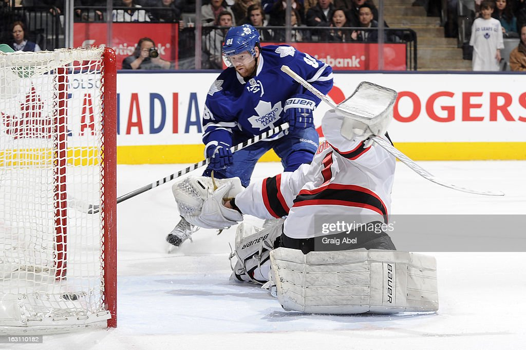 <a gi-track='captionPersonalityLinkClicked' href=/galleries/search?phrase=Phil+Kessel&family=editorial&specificpeople=537794 ng-click='$event.stopPropagation()'>Phil Kessel</a> #81 of the Toronto Maple Leafs scores a third period goal on <a gi-track='captionPersonalityLinkClicked' href=/galleries/search?phrase=Johan+Hedberg&family=editorial&specificpeople=202078 ng-click='$event.stopPropagation()'>Johan Hedberg</a> #1 of the New Jersey Devils during NHL game action March 4, 2013 at the Air Canada Centre in Toronto, Ontario, Canada.