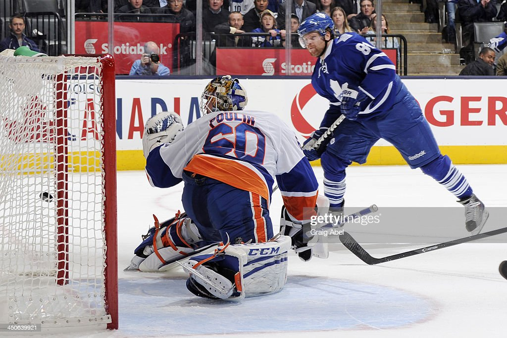 <a gi-track='captionPersonalityLinkClicked' href=/galleries/search?phrase=Phil+Kessel&family=editorial&specificpeople=537794 ng-click='$event.stopPropagation()'>Phil Kessel</a> #81 of the Toronto Maple Leafs scores a third period goal on <a gi-track='captionPersonalityLinkClicked' href=/galleries/search?phrase=Kevin+Poulin&family=editorial&specificpeople=4952456 ng-click='$event.stopPropagation()'>Kevin Poulin</a> #60 of the New York Islanders during NHL game action November 19, 2013 at the Air Canada Centre in Toronto, Ontario, Canada.