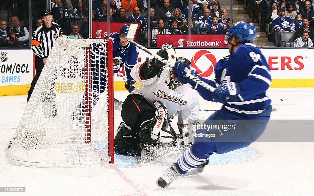 <a gi-track='captionPersonalityLinkClicked' href=/galleries/search?phrase=Phil+Kessel&family=editorial&specificpeople=537794 ng-click='$event.stopPropagation()'>Phil Kessel</a> #81 of the Toronto Maple Leafs scores his third goal on <a gi-track='captionPersonalityLinkClicked' href=/galleries/search?phrase=Jonas+Hiller&family=editorial&specificpeople=743364 ng-click='$event.stopPropagation()'>Jonas Hiller</a> #1 of the Anaheim Ducks during NHL action at the Air Canada Centre October 22, 2013 in Toronto, Ontario, Canada.